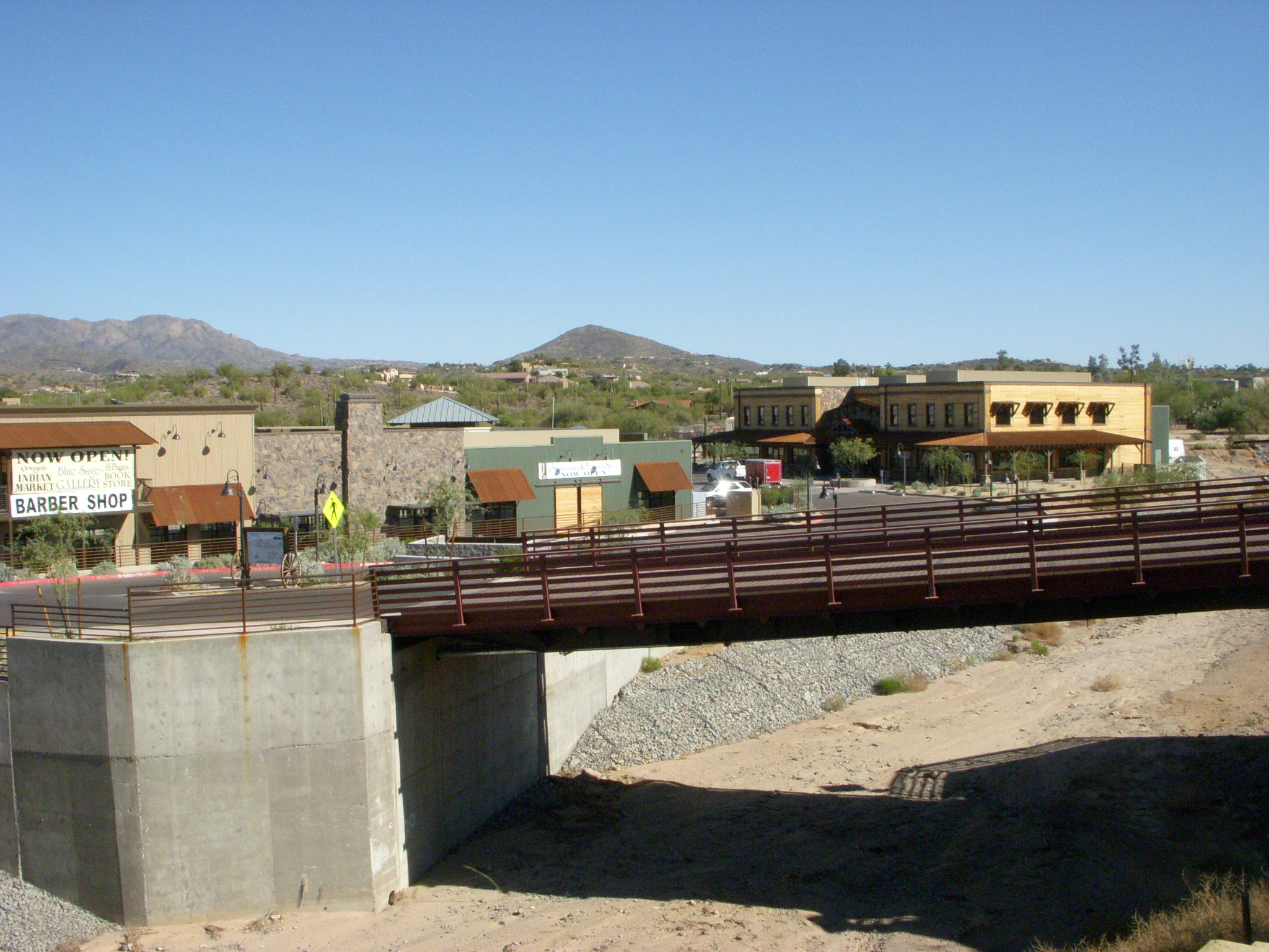 A bridge going over a wash at Stagecoach Village.