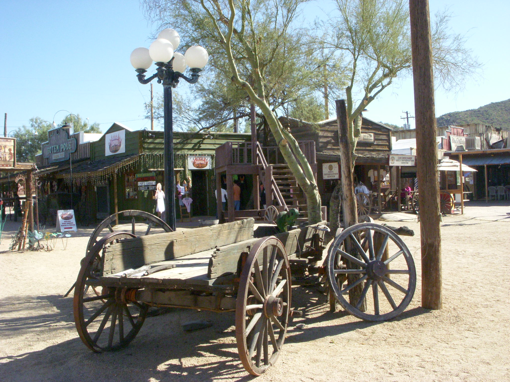 An old Western wooden wagon displayed outside the shops at Frontier Town.